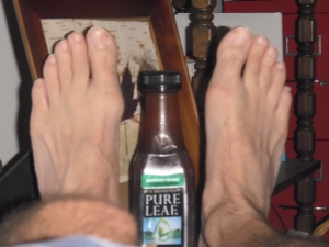 "From left to right: My good foot, formerly my bad foot until this morning; the world's worst iced tea; my new ""bad"" foot, already feeling better thanks to the healing powers of pulled pork barbeque."