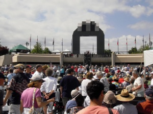 The crowd gathers beneath the Memorial Arch awaiting the 70th Anniversary Commemoration.