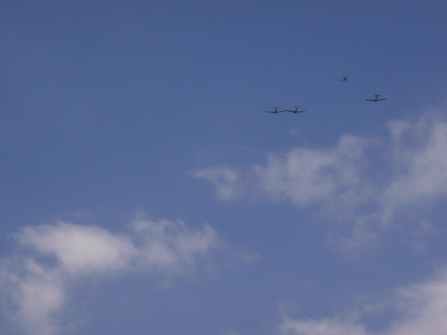 The final flyover: missing man formation.
