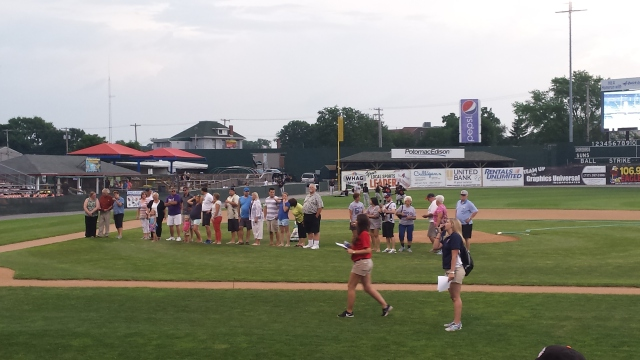 Relatives of former major leaguers from Washington County line up before the Hagerstown Suns game on Saturday, June 20.