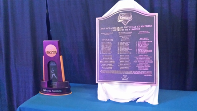 NCAA Championship trophy at left; this commemorative plaque will be placed at Davenport Field for all to see.