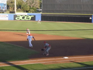Dunedin baserunner takes off for second in the early innings of Opening Night.