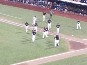 Coastal Carolina players run onto the field to celebrate their victory over TCU, which put them into the finals.