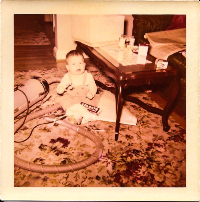 Even then I had issues with toothpaste. For you kids out there, that thing on the floor next to me is a vacuum cleaner.